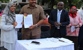 Dr. Hashina Begum, Acting Country Representative UNFPA Tanzania with Hon. Mahmoud Thabit Kombo Health Minister in Zanzibar.. showing the signed handing over agreement